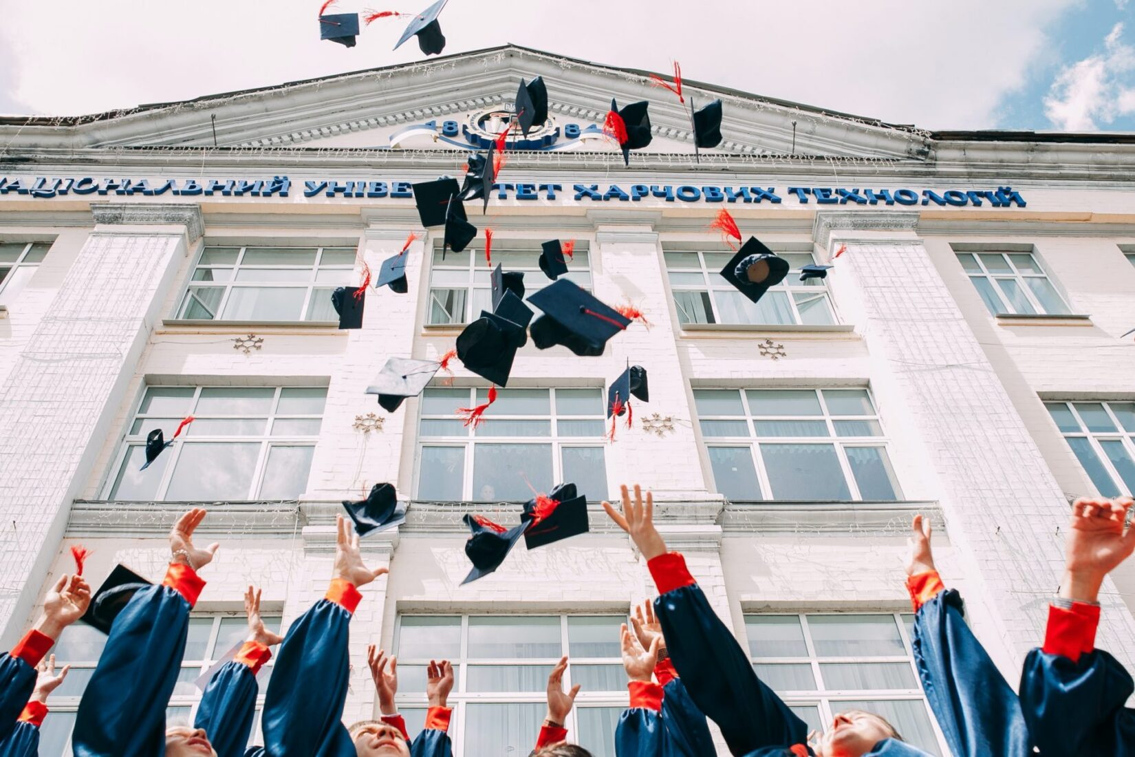 College graduates throwing their caps in the air
