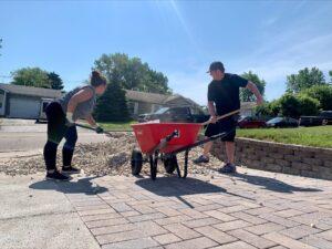 Titus Talent's EOS Team members shoveling rocks