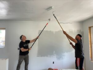 Titus Talent's EOS Team members painting