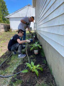 Titus Talent's EOS Team members planting plants