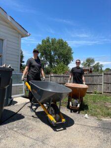 Titus Talent's EOS team members pushing wheelbarrows